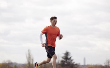 image of man running wearing run shorts