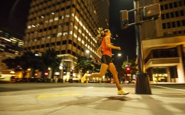 woman running in the city streets at night