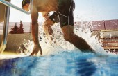 image of man leaving swimming pool